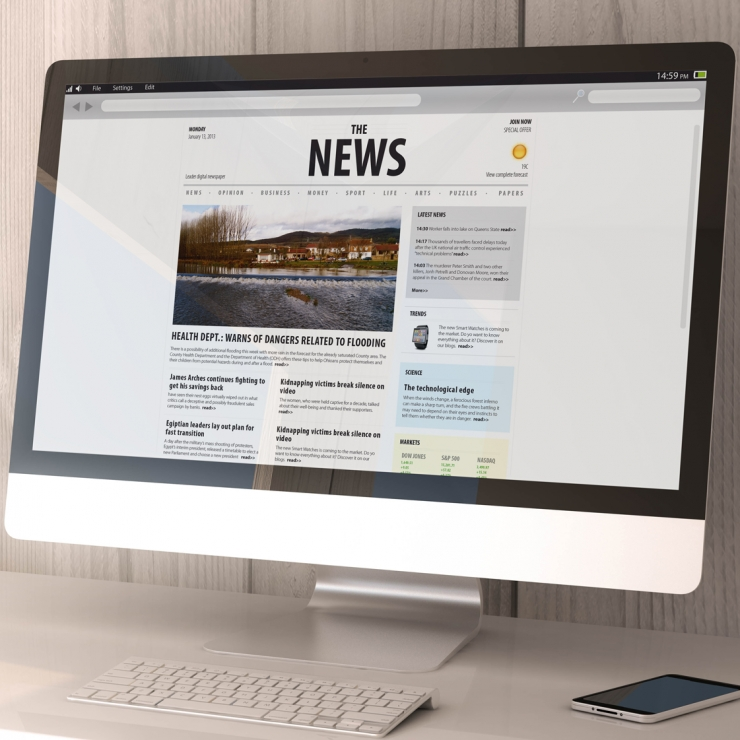 Desktop computer showing a news website